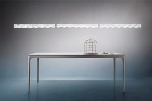hugo suspension lamp above a modern table with sea shell