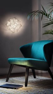 veli couture wall above a green armchair